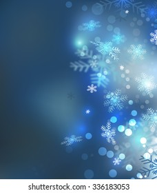 Christmas background with snowflakes and bokeh light