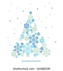 Christmas background with tree silhouette formed  by  snowflakes