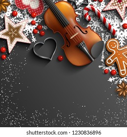 Christmas background, violin, gingerbread cookies, ornaments, candy canes and anise stars laying on black background, with text Let it snow, vector illustration, eps 10 with transparency