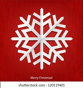 Christmas background with white paper snowflake.