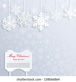 Christmas background with white snowflakes and frame with inscription