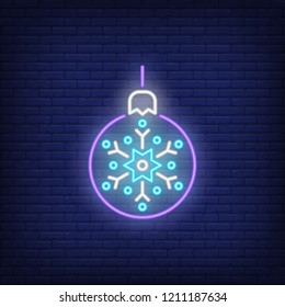 Christmas ball neon sign. Luminous signboard with purple bauble with snowflake. Night bright advertisement. Vector illustration in neon style for decoration, decor