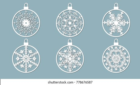 Christmas balls set with a snowflake cut out of paper. Templates for laser cutting, plotter cutting or printing. Festive background.