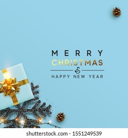 Christmas banner. Background Xmas design of sparkling lights garland, with realistic gifts box, black snowflake, brown pine cone.