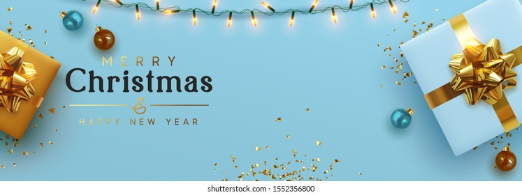 Christmas banner. Background Xmas design of sparkling lights garland, realistic gifts box, blue balls and glitter gold confetti. Horizontal christmas poster, greeting cards, headers website