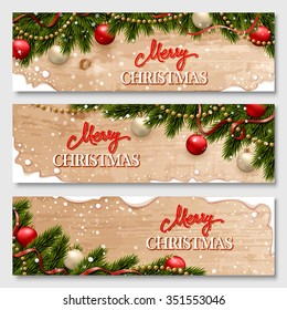Christmas banners set with fir branches decorated with ribbons, red and gold balls and garlands. With snow frames and wood texture background.
