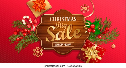Christmas big sale banner for New Year holidays. Discount template on wooden frame on red background with traditional christmas elements-gift box with gold bow,candy,branch.Vector illustration.