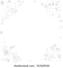 Christmas border or frame with random scatter falling silver snowflakes isolated on white.