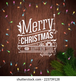 Christmas card with typography design. Wooden background, realistic garland and Christmas tree. Vector illustration.