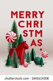 Christmas composition made of little evergreen trees, candies and red traditional Scandinavian Dala horse