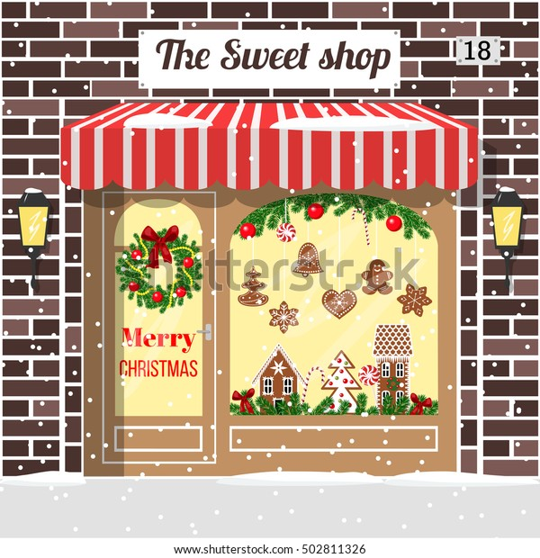Christmas decorated and illuminated sweet shop, candy store, confectionery. Cozy Brick building facade with entrance, awning, door, shopfront, gingerbread man, wreath, garland, lollipop, lamps. vector