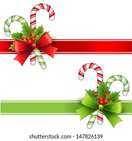 Christmas decoration with holly leaves, bow  and candy