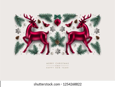Christmas Decorative Composition made of Pine Branches, Ornaments, Glitter Snowflakes,  and  Glass Deer. Flat lay, top view.