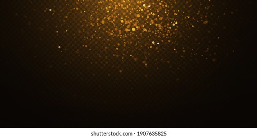 Christmas falling golden lights. Magic abstract gold dust and glare. Festive Christmas background. Abstract golden particles and glitter on a black background.