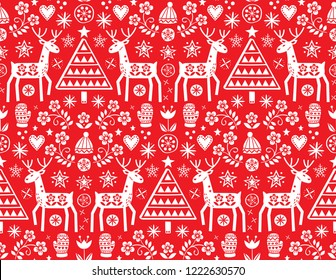 Christmas folk art vector seamless pattern with reindeer, flowers, Xmas tree and winter clothes design in white on red background - Merry Christmas ornament. Cute Scandinavian style decoration