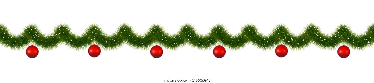 Christmas garland with red balls. New year decorations covered with snow