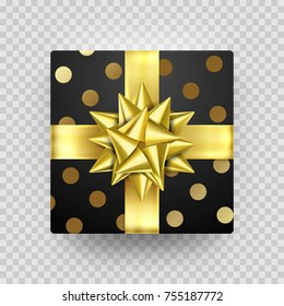 Christmas Gift box present in golden ribbon bow and wrapping paper dotted pattern. Vector Christmas gold foil gift box isolated on transparent background for New Year holiday or Birthday greeting card