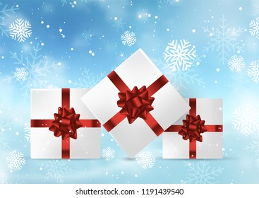 Christmas gifts on a snowflakes and bokeh lights background