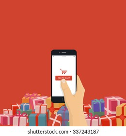 Christmas gifts online shopping. Hand holding mobile phone with add to cart button, modern flat design illustration.