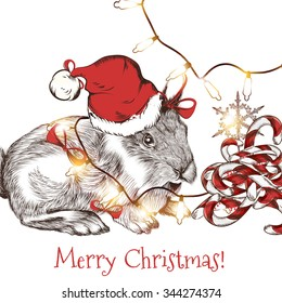 Christmas greeting card with cute hare in Santa hat with garlands and candies