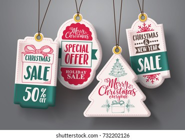 Christmas hanging sale tags vector set in white color with different shapes and greetings and discount text for christmas holiday marketing promotions. Vector illustration.
