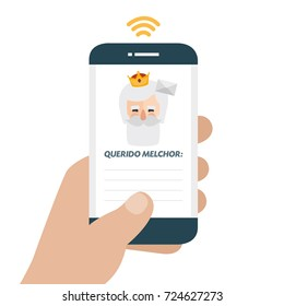 Christmas is here. Send your letter to The three wise men of orient from your cell phone. Hand holding smartphone. Dear Melchior written in spanish