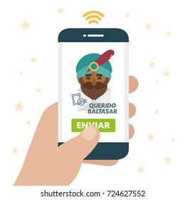 Christmas is here. Send your letter to The three wise men of orient from your cell phone. Hand holding smartphone. Dear Balthazar written in spanish