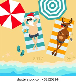 Christmas holiday. Santa Claus and deer Rudolph relax on the beach. Greeting Christmas card 2017