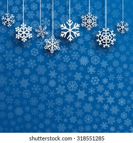 Christmas illustration with several hanging snowflakes on blue background