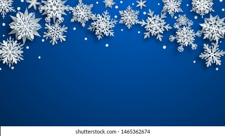 Christmas illustration of white complex paper snowflakes with soft shadows on blue background