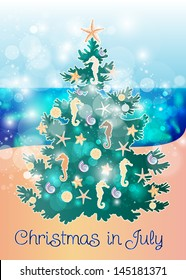 Christmas in July: Fir tree decorated with ocean creatures on a sandy beach