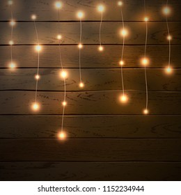 Christmas lights isolated on dark wooden background. Glow garland. Vector glow xmas light bulbs on wires.