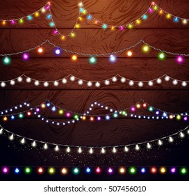 Christmas lights set, colored garlands, New Year design,festive decorations on wooden background. Flat vector illustration, wood texture. Separated editable elements under masks, brushes for creation.