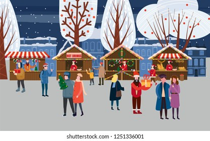 Christmas market or holiday outdoor fair on town square. People walking between decorated stalls, canopy or kiosks, buying snacks, gifts, decoration and drinking hot coffee, tea and mulled wine