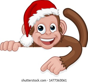 A Christmas monkey animal cartoon character in a Santa hat behind a sign peeking over a sign and pointing at it