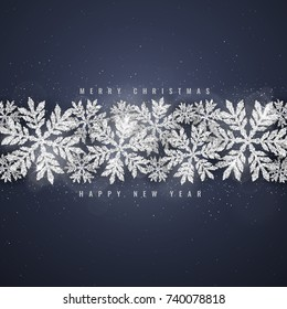 Christmas and new year dark blue background with silver glittering snowflakes on dark background. Merry Christmas greeting card.