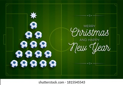 Christmas and new year greeting card. Creative Xmas tree made by soccer football ball on football field background for Christmas and New Year celebration. Sport greeting card