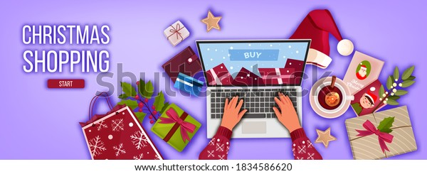 Christmas online shopping banner with laptop top view, hands, presents, bag, Santa hat. Winter holiday x-mas sale offer background with gift boxes, wallet,bank card.Christmas internet shopping concept