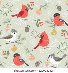 Christmas pattern with cute winter birds, mistletoe, holly berry, Christmas ornaments, pine cones and pine branches on snow background