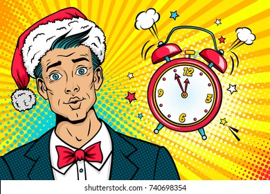 Christmas pop art face. Surprised young man in Santa Claus hat, suit and bow tie and  bright makeup and alarm clock ringing. Vector illustration in retro comic style. New year party invitation poster.
