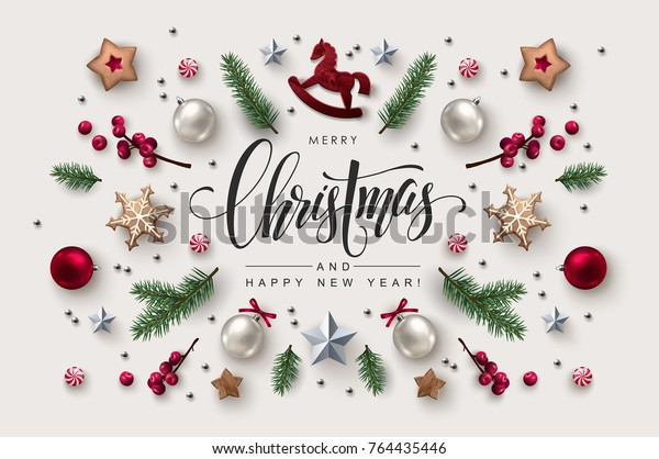 Christmas postcard with Calligraphic Season Wishes and Composition of Festive Elements such as Cookies, Candies, Berries, Christmas Tree Decorations.