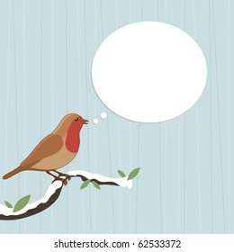 christmas robin red breast perched on branch with speech bubble ready for text