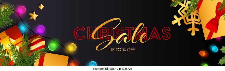Christmas Sale lettering with sparkling colorful light bulbs, presents and fir branch on dark blue background. Up to percent lettering can be used for posters, leaflets, announcements