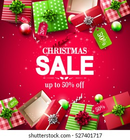 Christmas sale poster with red and green gift boxes with price tags