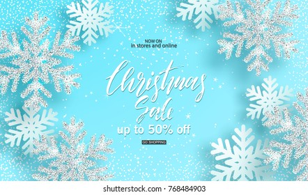 Christmas sale. Poster with shiny silver snowflakes on a blue background. Vector illustration