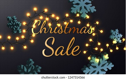 Christmas sale. Promotion Poster or banner with black and gold style text and 3d snowflake with realistic christmas lights. Promotion or shopping design template for Christmas or New Year.Vector EPS10