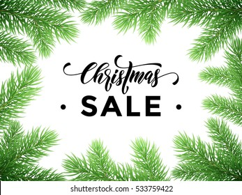Christmas Sale text on pine tree branches background. New Year sale promotion placard for shop. Calligraphy lettering text. Promo shopping offer banner