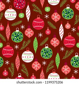 Christmas seamless pattern with fir branches, balls, baubles and snowflakes on dark red background. Perfect for holiday invitations, winter greeting cards, wallpaper and gift paper