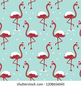 Christmas seamless pattern with flamingo in red hat under snow.