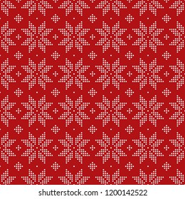 Christmas seamless pattern of snowflakes big classic knitted pattern of small circles of white dots on a bright red background.